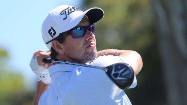 Golfer Adam Scott in action.