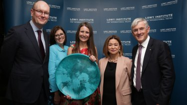 Fairfax Media's Indonesia correspondent Jewel Topsfield accepts the 2016 Lowy Institute Media Award in Sydney on Thursday night. From left to right: Michael Fullilove, Jane Anderson, Jewel Topsfield, Michelle Guthrie and Steven Lowy.
