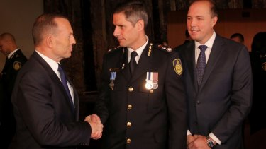 Prime Minister Tony Abbott at the swearing in ceremony of the inaugural Border Force Commissioner Roman Quaedvlieg with Immigration Minister Peter Dutton last month.