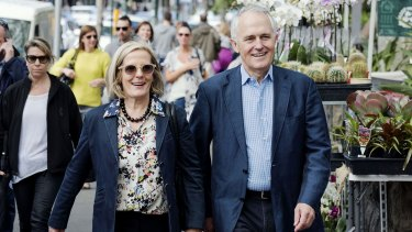 Power walkers: Lucy and Malcolm Turnbull stroll through Paddington last month.
