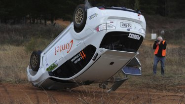 A passenger got more than expected with a rollover on the last corner of his hot-lap.