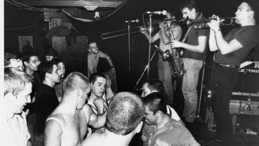 An early Strange Tenants gig: high energy crowds and music.