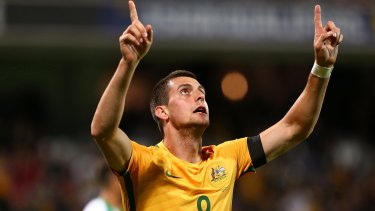 Tom Juric celebrates a goal in the World Cup qualifier against Iraq in September.