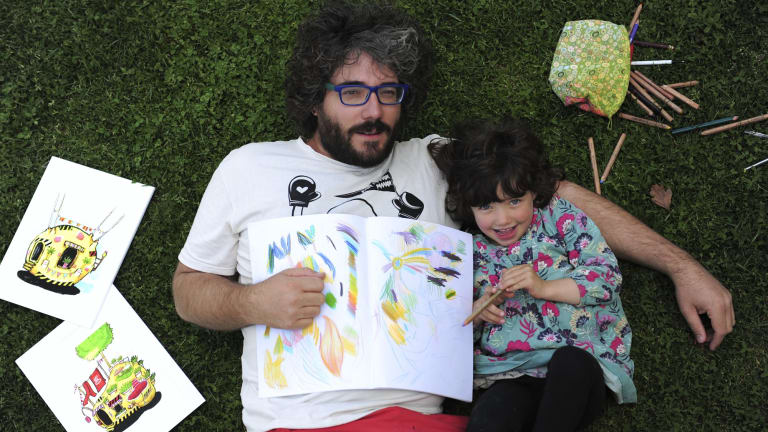 Artist Paul Summerfield and daughter Sumi Zemita, 4, with some examples of the work in his new colouring book.