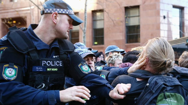 Police jostle with anti-Reclaim Australia protesters in Martin Place.