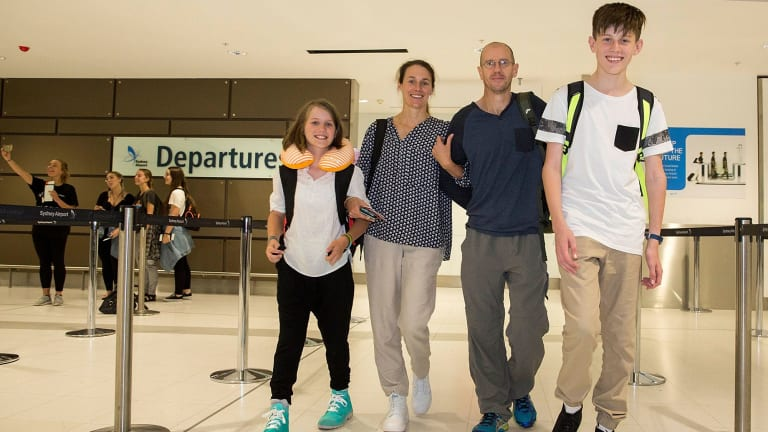 Kristie Ward and Jim Walters with children Ethan and Ashlyn at Sydney Airport on Friday.