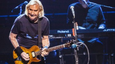 Joe Walsh's impassioned guitar solos were among the night's few unpredictable elements.