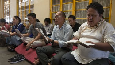 Exiled Tibetans in India pray to remember Tibetan lama Tenzin Delek Rinpoche, 65, who died in custody in a Chinese prison.