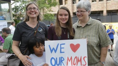 Beth Sherman (left) and her wife Karen Hawver (right) celebrate with their children Ben and Emma (centre) the US Supreme Court's landmark ruling of legalising gay marriage nationwide, at a rally in Ann Arbor, Michigan.