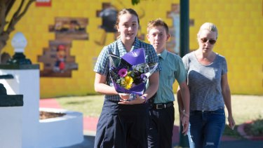 Locals leave flowers at Dreamworld on Wednesday morning.