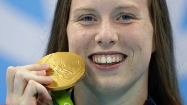 United States' Lilly King shows off her gold medal.