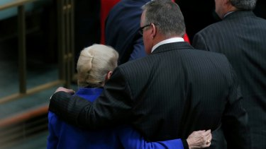 Coalition MP Ewen Jones walks out of the chamber with former Speaker Bronwyn Bishop after incoming Speaker Tony Smith was 'dragged' to the Speaker's chair.