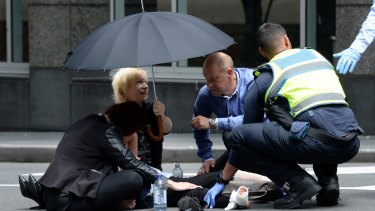 Bystanders comforted the injured in Bourke Street.