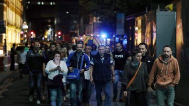 Members of the public are led away from the scene near London Bridge.