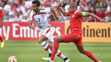 Iran's Masoud Shojaei (left) is challenged by Bahrain's Mohamed Hasan.