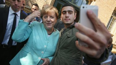 In September German Chancellor Angela Merkel posed for a selfie with a migrant from Syria after she visited a shelter for migrants in Berlin.