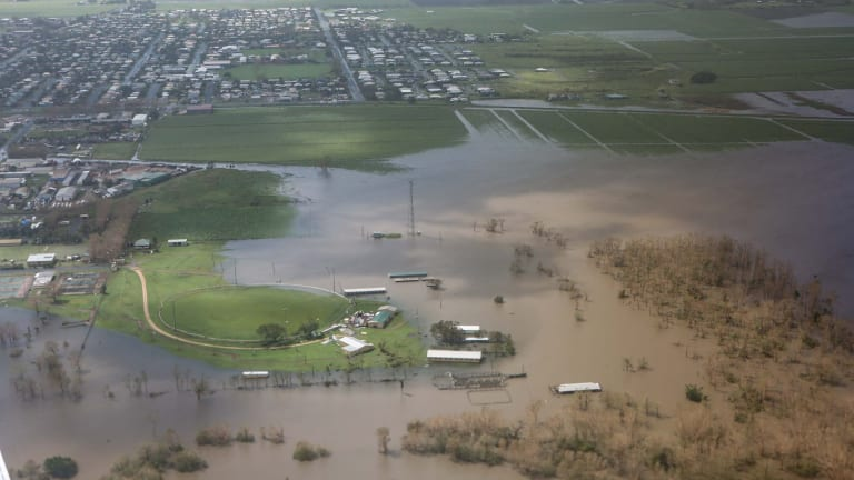 Widespread flooding hit north Queensland in the wake of Cyclone Debbie.