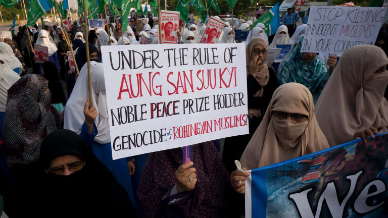 Supporters of Pakistani religious party Jamaat-e-Islami stage a rally in Pakistan to condemn ongoing violence against the Rohingya Muslim minority in Myanmar.