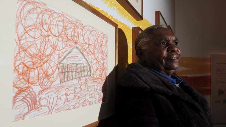 """Tess Napaljarri Ross in front her work: """"Remembering a dust storm at Yuendumu in the 1970s""""."""