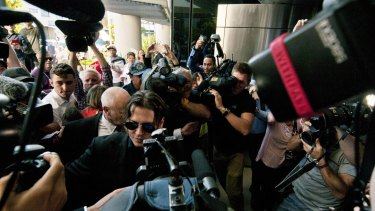 Johnny Depp and Amber Heard receive attention outside court.