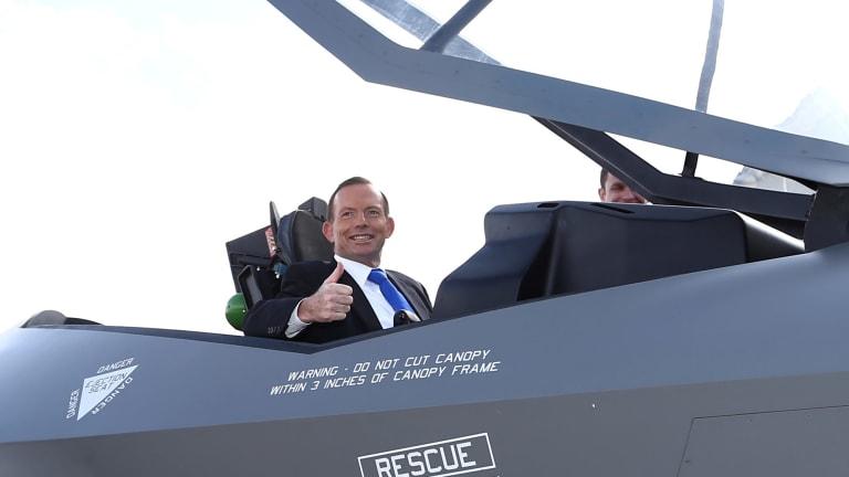 Then prime minister Tony Abbott in a replica F-35 jet in Canberra in 2014.