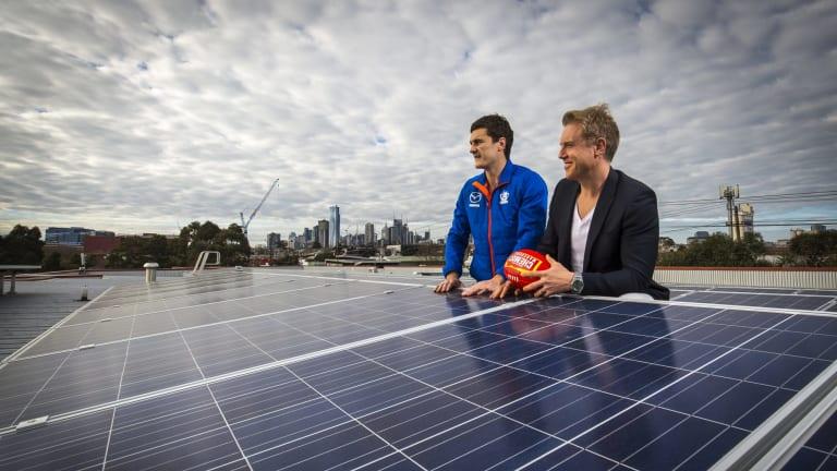 Melbourne councillor Arron Wood, right, with North Melbourne footballer Scott Thompson.