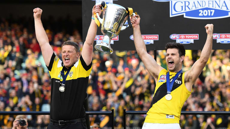 Damien Hardwick and Trent Cotchin celebrate with the premiership cup.