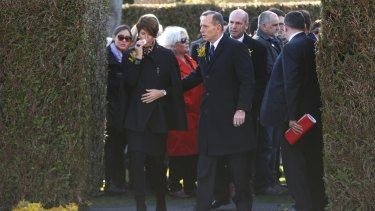 Prime Minister Tony Abbott and wife Margie depart after placing a wreath at the national MH17 memorial on Friday.
