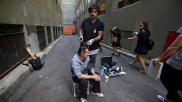 Nas gives Daniel a haircut.