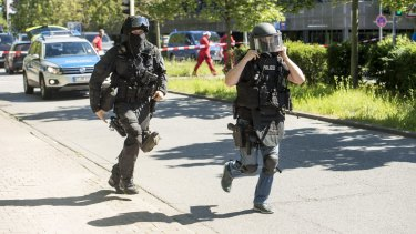 Heavily-armed police outside a movie theatre complex where an armed man has reportedly opened fire in Viernheim, Germany.