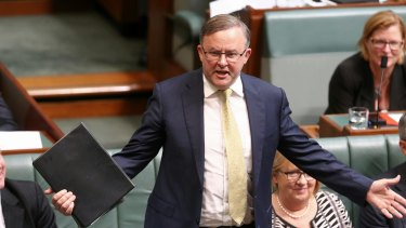 """Labor's infrastructure spokesman Anthony Albanese claims Mr Abbott now """"embarrassed"""" by his record in the area."""