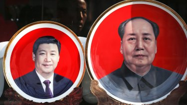 Souvenir plates bearing images of Chinese President Xi Jinping, left, and Mao Zedong  at a shop near Tiananmen Square in Beijing.