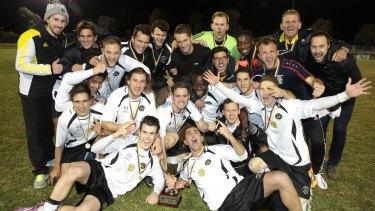 Gungahlin United players celebrate their FFA Cup qualifying final win.