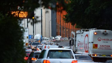 Traffic heading north towards the Sydney Harbour Bridge: the cost of such congestion stretches into billions of dollars every year.