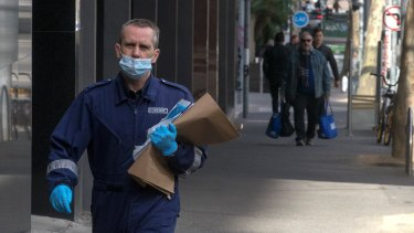 A forensic officer enters the Oaks on Market.