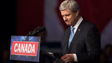 Conservative Leader Stephen Harper pauses while addressing supporters after defeat in Calgary, Alberta, on Monday.
