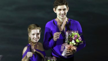 Ekaterina Alexandrovskaya and Harley Windsor celebrate after winning the junior pairs free skating program at the junior world championships in 2017.