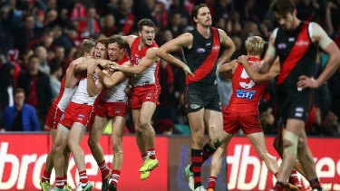 Bombed: Gary Rohan is mobbed by Sydney teammates after booting the winning goal.