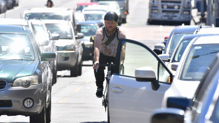 A cyclist makes his way along Sydney Road in Brunswick.