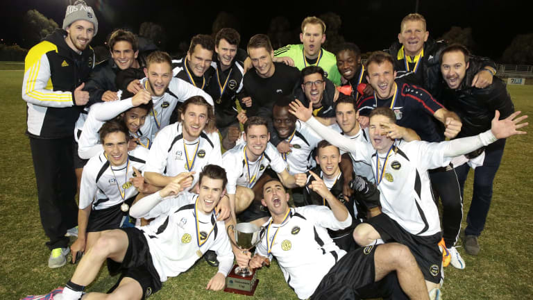 Gungahlin United players celebrate their FFA Cup qualifying final win.