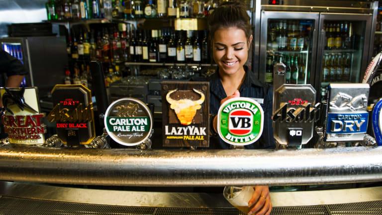The end of cheap beer? Hellenic Club bartender Jaimee Bain behind the taps.