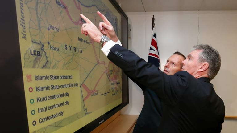 ASIO director-general Duncan Lewis gives a briefing to then prime minister Tony Abbott in June.