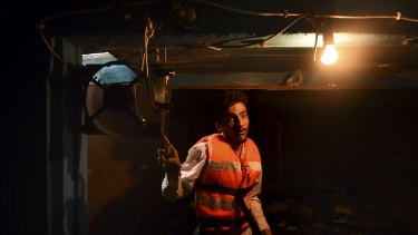 Mohamed, 25, of Pakistan, in the hull of the wooden fishing boat that he shared with the 52 people who died.