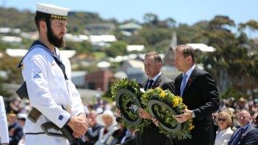 Tribute: Tony Abbott and his New Zealand counterpart John Key lay wreaths at the Anzac Peace Park on Saturday.