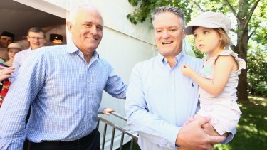 Holding fast: Malcolm Turnbull and Cormann during Family Day at The Lodge.