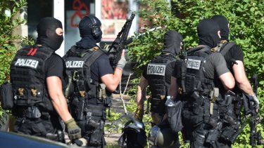 Heavily armed police officers at the scene.