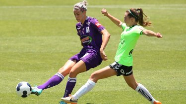Canberra's Grace Maher challenges Perth Glory's Alanna Kennedy.