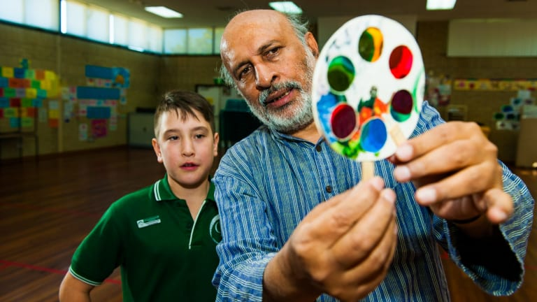 Indian toy maker and science educator Arvind Gupta, visits Charnwood-Dunlop Primary School with year 6 student Marcus Andreatta 11, holding a mini-workshop showing toys made from trash.