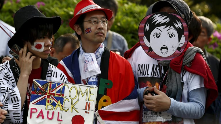 Fans wait for the arrival of Paul McCartney before his gig at the Nippon Budokan Hall.