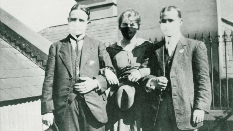 People wearing face masks during influenza epidemic in Sydney, 1919.